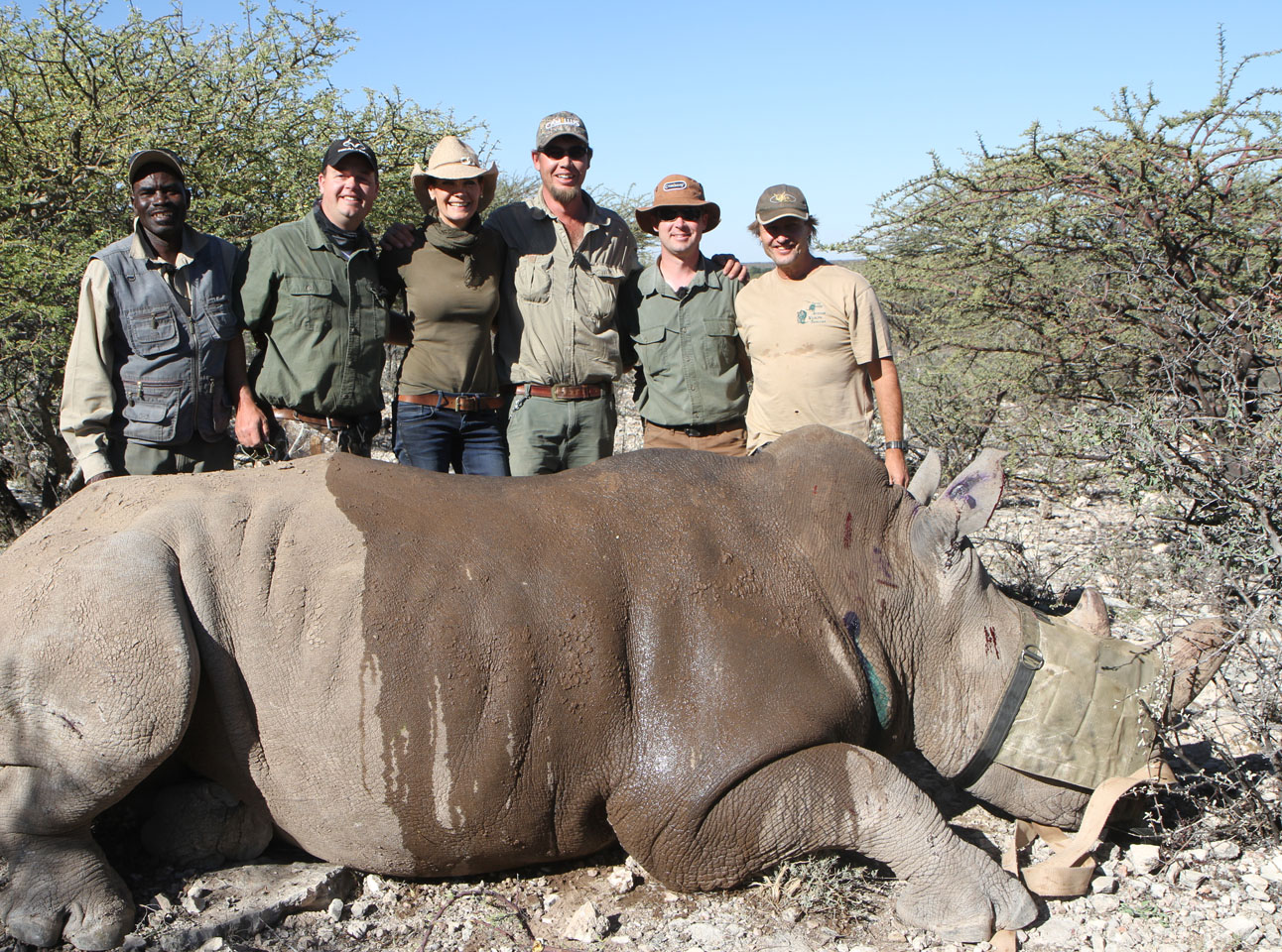 hunters with Dead Rhino