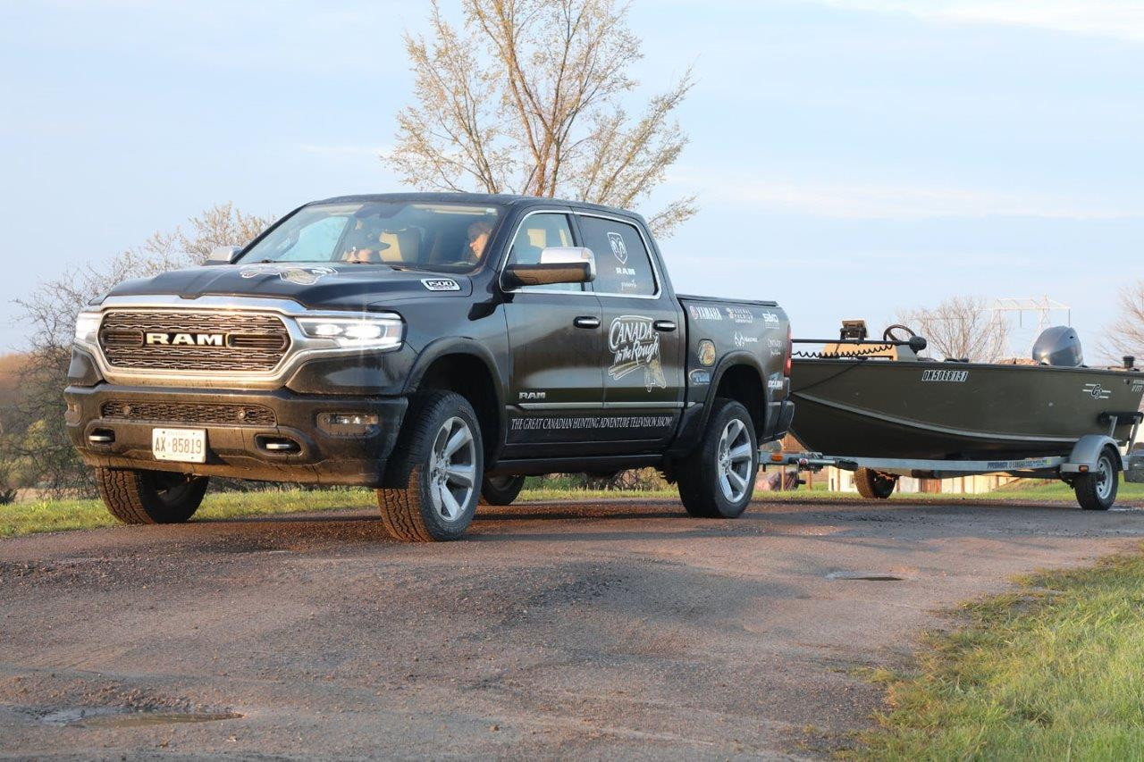 black dodge ram truck with a boat trailer