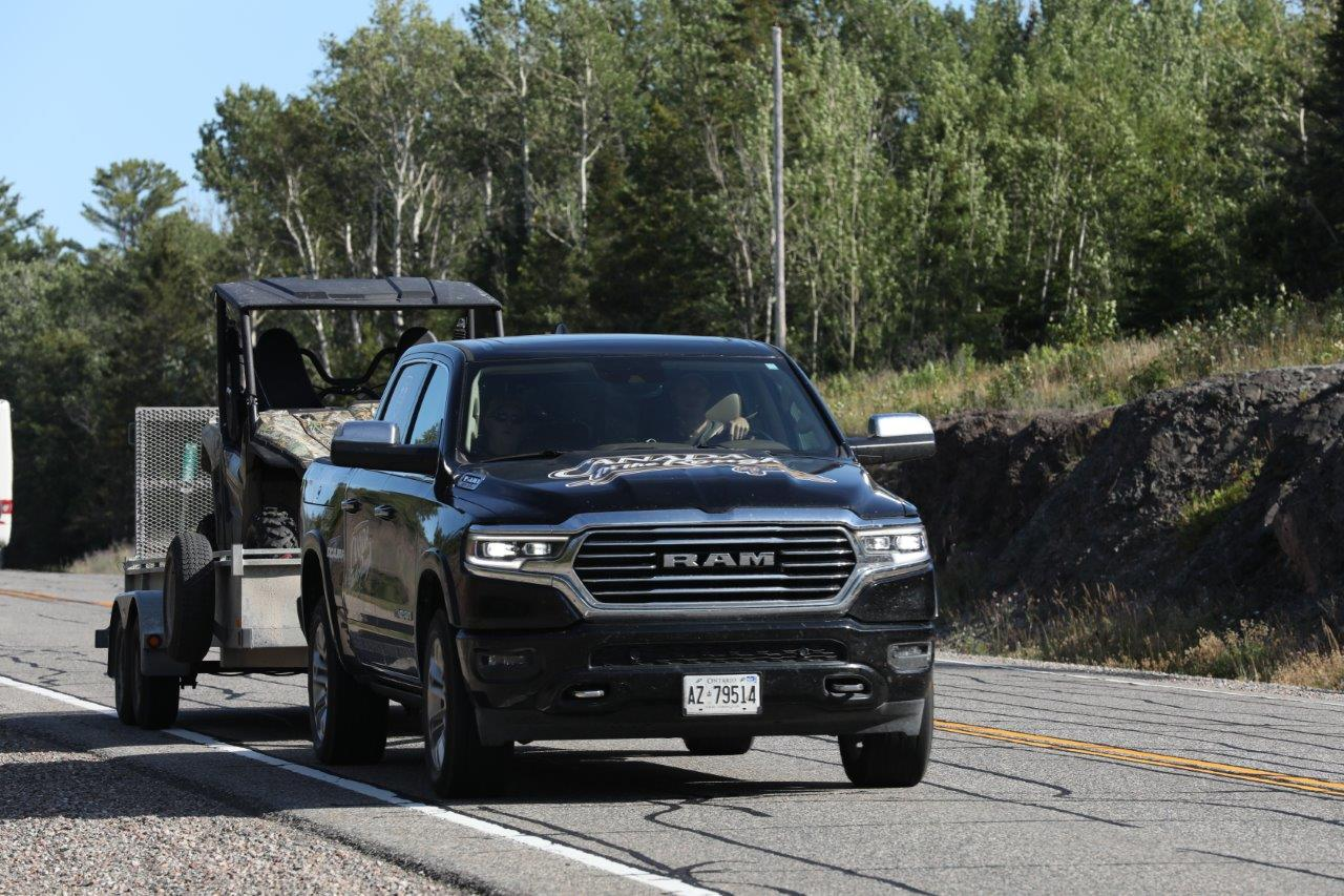 black dodge ram truck with a trailer with a ATV
