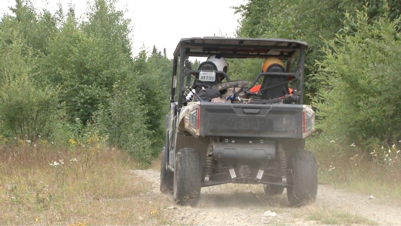 hunters riding Yamaha ATV