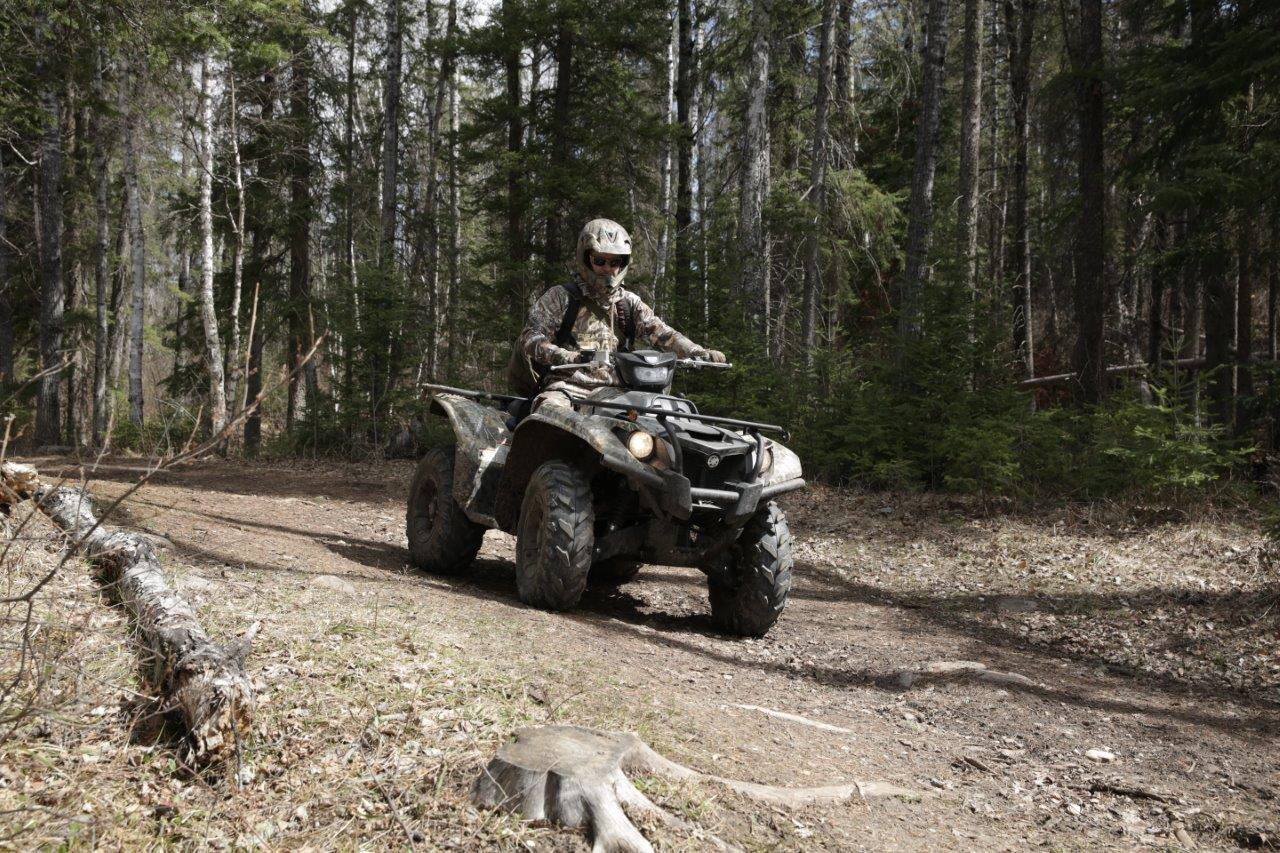 hunter riding Yamaha ATV