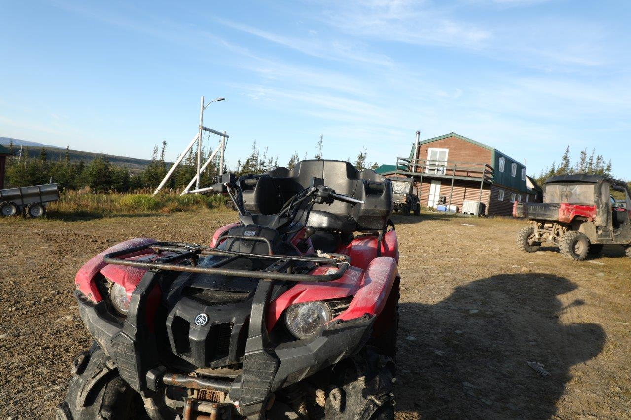 ATV and barn in the background