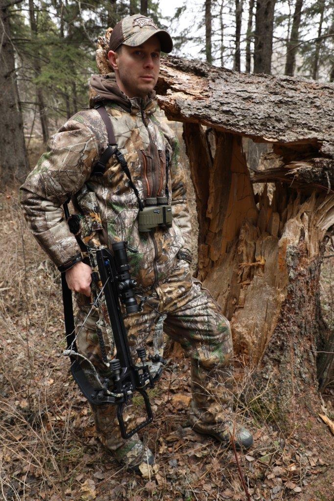 hunter next to a fallen tree