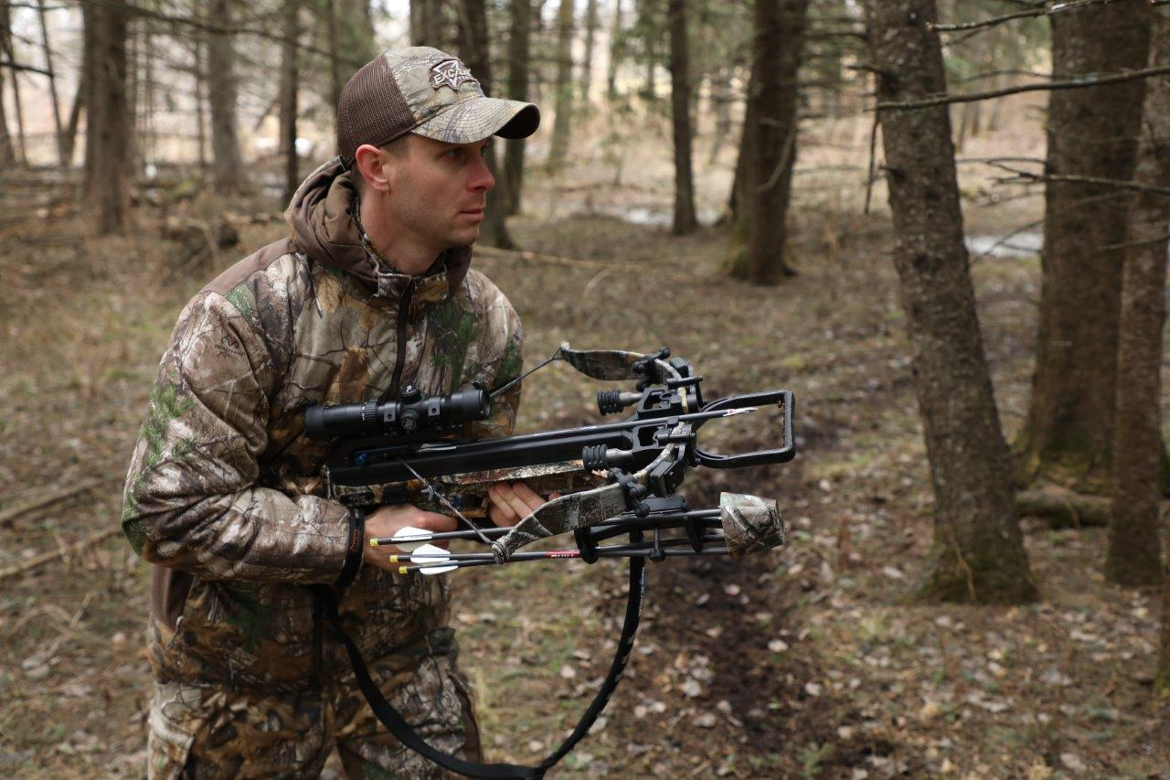 hunter holding a compound crossbow